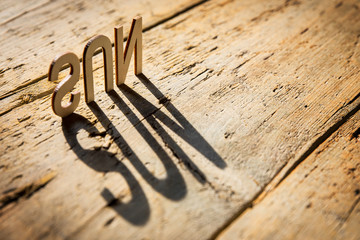 Wooden letters build the word sun