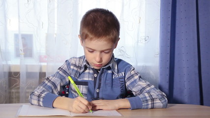 closeup child doing homework, to do the job, 1080p video