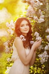Young spring fashion woman  in spring garden. Springtime. Trendy