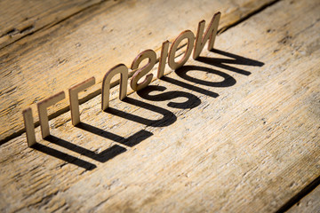 Wooden letters build the word illusion