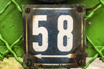 Weathered enameled plate number 58