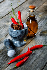 Still-life of spice and mortar on a old wooden table
