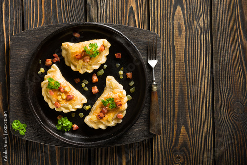 Fotobehang Restaurant Fried dumplings with onion and bacon top view