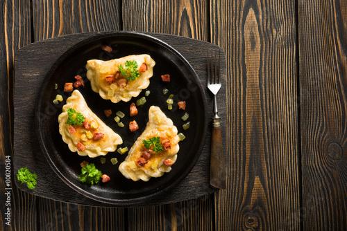 Deurstickers Klaar gerecht Fried dumplings with onion and bacon top view