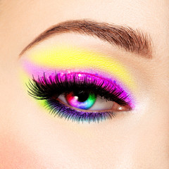 Close-up female eye with beautiful fashion bright vivid make-up