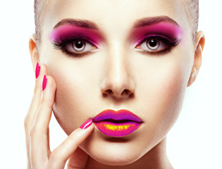 face of a beautiful  woman with vivid colors of eye make-up and