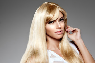 Beauty young woman, luxury long blond hair. Haircut, fringe. Gir