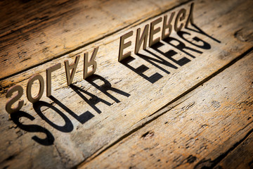 Wooden letters build the word solar energy