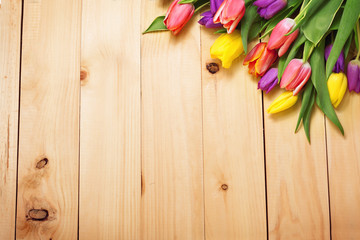 Spring Flowers bunch at wood floor texture. Beautiful Tulips bou