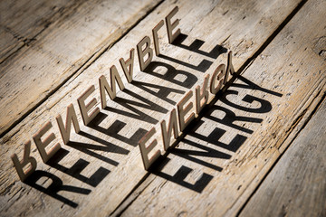 Wooden letters build the word renewable energy