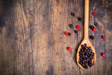 viburnum and black currant on wooden background