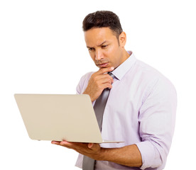 mid age businessman reading email on his laptop