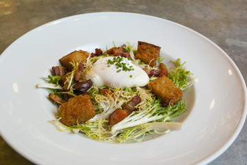 Frisee Salad with Lardon, Poached Egg and Croutons