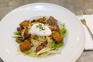 Frisee Salad with Lardon, Poached Egg and Croutons