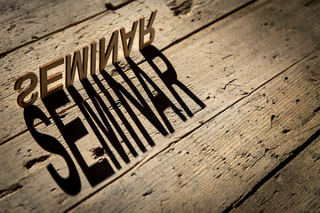 Wooden letters build the word seminar