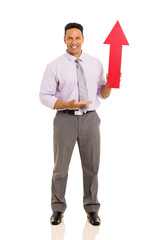 mid age man showing arrow symbol