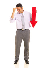 mature businessman holding arrow pointing down