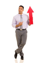 mid age businessman pointing red arrow symbol