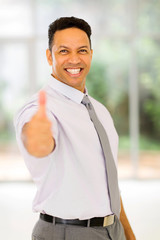 mid age business executive giving thumb up