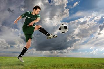Soccer Player Kicking Ball Outdoors