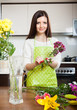 housewife doing  bouquet on  kitchen