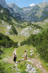 Two Hikers On Path Of Durmitor National Park, Montenegro
