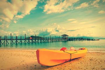 Yellow kayak on beach