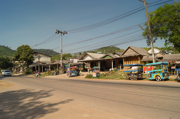 the daily life of a Thai village along the road