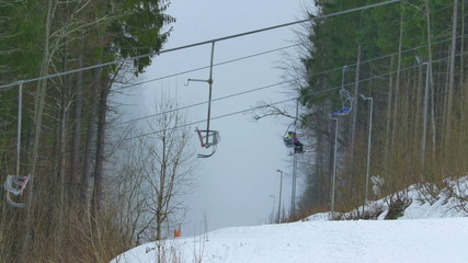 The mountain and work lift, foggy cyclone weather