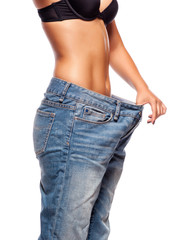 Close up of a woman belly in too big pants