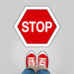 Stop Concept, Person Standing in Front of Sign