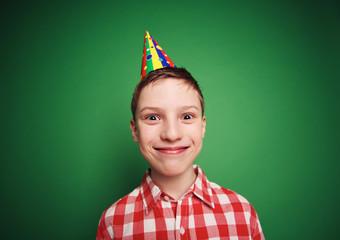 Boy in birthday cap