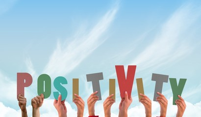 Composite image of hands showing positivity