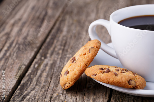 Cup of coffee with cookies on a wooden table. - 80839151