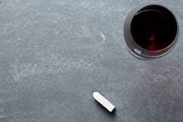 glass of wine on chalkboard
