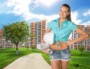 Girl builder holding paper scrolls, helmet. Green hills, road