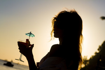 silhouette of young happy woman enjoying summer beach vacation a