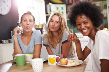 Three Female Friends Enjoying Breakfast At Home Together
