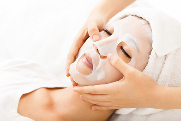 young lady with Facial mask at spa
