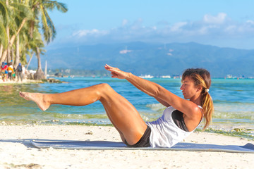 young beautiful woman doing bodyflex, fitness, sport workout out