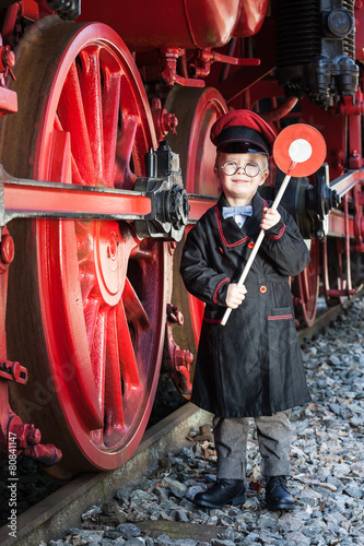 Leinwanddruck Bild Little Train Conductor Boy