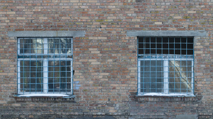 Two windows with old iron bars