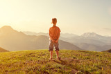 Toddler enjoys view over the mountains