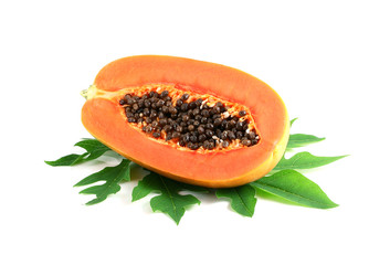 sweet papaya on the dish with green papaya leaf