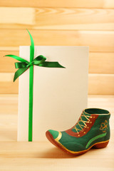 Greeting card for Saint Patrick's Day with leprechaun shoe