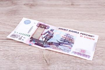 One denomination on wooden background