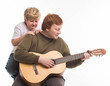 Постер, плакат: Fat Boy with Guitar Hobby Playing on White Background
