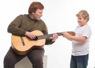 Fat Boy with Guitar Hobby Playing on White Background