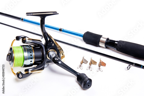 Fishing rod and reel isolated on white. - 80844753