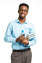 Happy african american college student with books and bottle of